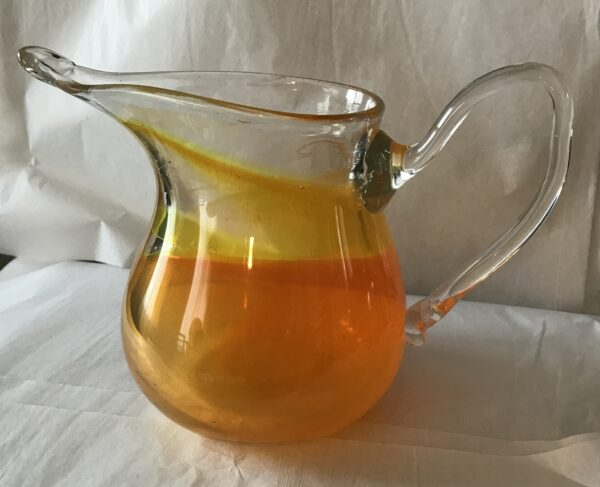 G454b – Yellow orange pitcher clear handle – signed D D Bremer – 6_5W x 9T – 125