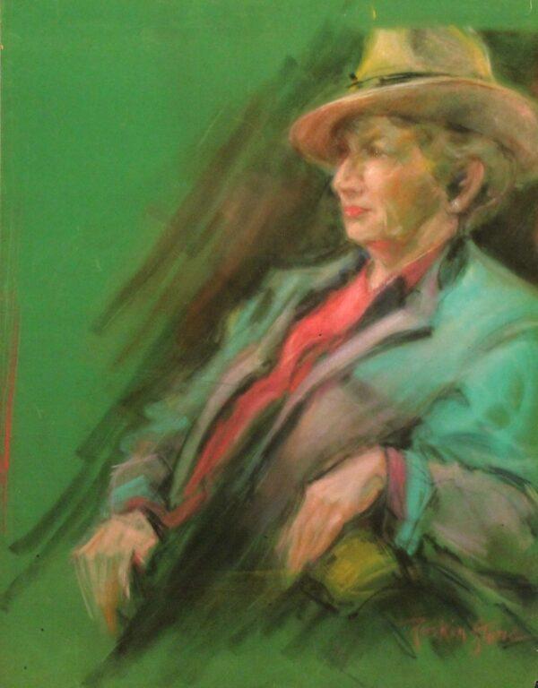R210 Woman in a hat wearing a green jacket